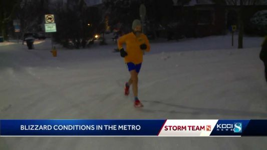 Shorts and all, blizzard conditions won't stop Iowa runner