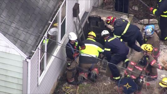 'Just pray': Porch collapses, woman pinned under 1,500-pound concrete slab