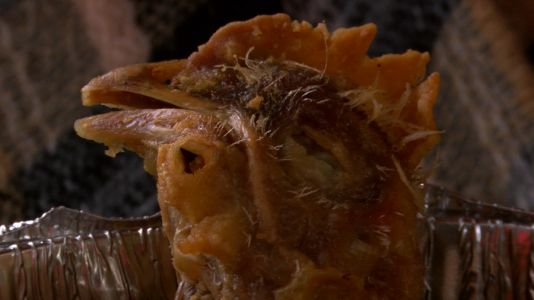 Woman claims fried chicken head found in takeout order