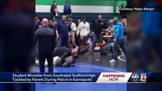 VIDEO: Father rushes, tackles his son's competitor at high school wrestling match