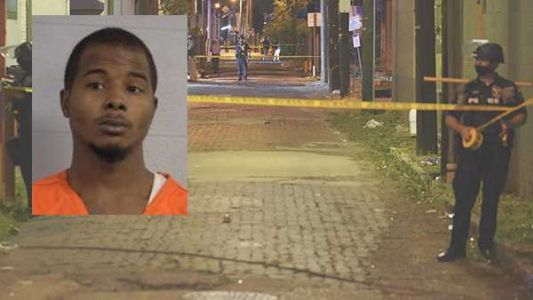 Arrest made after 2 Louisville officers wounded in downtown shooting