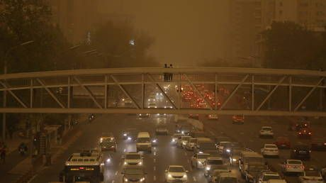 Beijing engulfed in yellow dust as authorities issue blue alert for sandstorms in central China