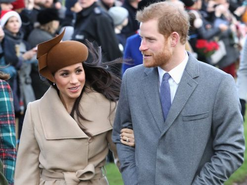 Prince Harry and Meghan Markle appeared to shun royal precedent by linking arms in Prince Louis' official christening portrait
