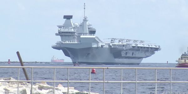 Britain's biggest warship had to deal with Hurricane Florence while training with F-35 jets for the first time