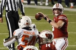 Mertz, No. 14 Wisconsin rout Illinois 45-7 in Big Ten opener