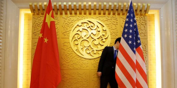 China retaliates against US sanctions with its own, targeting 11 US citizens in political skirmish