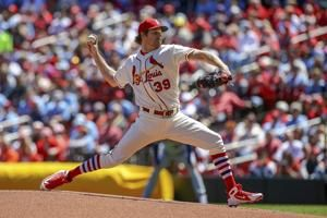 Mikolas leads Cardinals with arm and bat, beats Mets 10-2