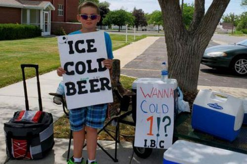 Utah boy showcases 'Ice Cold Beer' sign at root beer stand