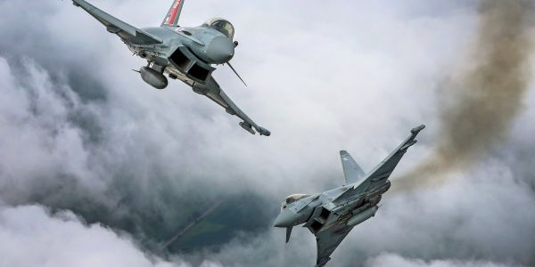2 Royal Air Force fighter jets were scrambled to escort a British passenger plane home after an 'extremely disruptive' customer tried to open the door mid-flight
