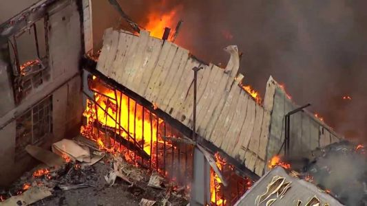 Massive fire engulfs structure in New Albany