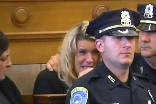 Widow of slain officer breaks down, berates suspect in court