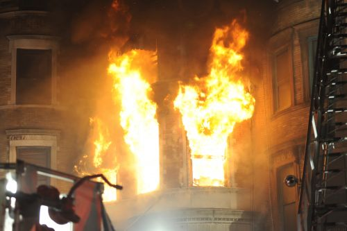 Firefighter seriously injured as massive fire rips through NYC building