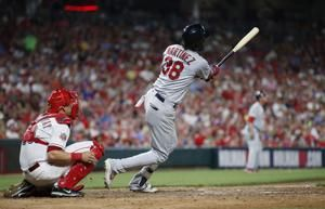 Martinez, Cards score 10 runs in 6th, rally past Reds 12-11