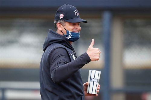 Beaming Aaron Boone back with Yankees after health scare