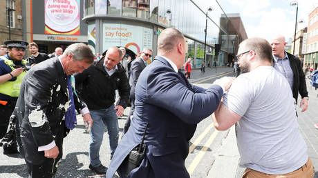 £350 milkshake: Man who doused Farage's suit with ice-cold dessert ordered to pay compensation