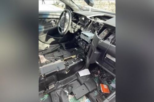 Photos show an unmarked NYPD car completely stripped after being stolen