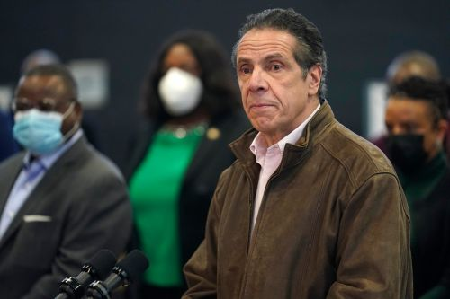 Former aide charges Cuomo kissed, sexually harassed her