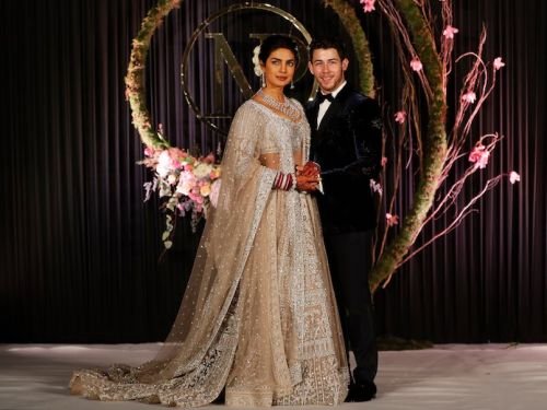 Priyanka Chopra wore a silver lehenga covered in sequins for her wedding reception with Nick Jonas