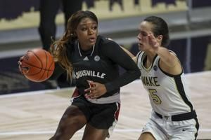 Louisville, NC State survive upset bids to remain atop poll