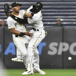 Collision sends Pirates' Gonzalez, Marte to injured list