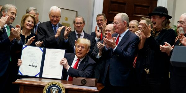 WATCH: Trump signs bill that ensures music streaming services pay artist royalties
