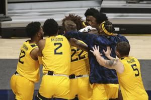 McBride, No. 11 West Virginia rally past No. 10 Texas Tech