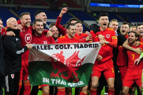 Gareth Bale celebrated with a flag that read 'Wales. Golf. Madrid. In that order' after he helped secure his country's qualification to Euro 2020
