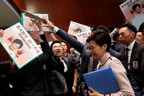 Hong Kong leader Carrie Lam shouted down as she attempts to deliver address