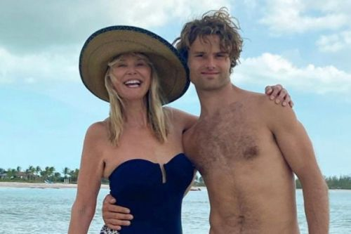 Christie Brinkley and son Jack pose in swimsuits on the beach