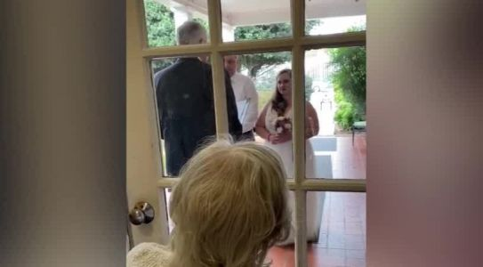 Virginia couple holds wedding ceremony outside living facility for grandmother to see