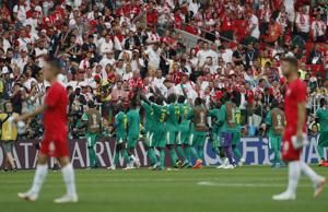 Senegal beats Poland 2-1, 1st African win at World Cup
