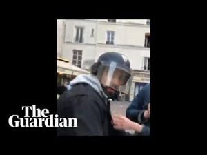 Macron's security officer filmed beating protester