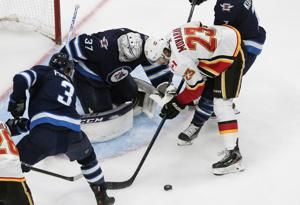 Flames beat Jets 4-0 in Game 4, win qualifying round series