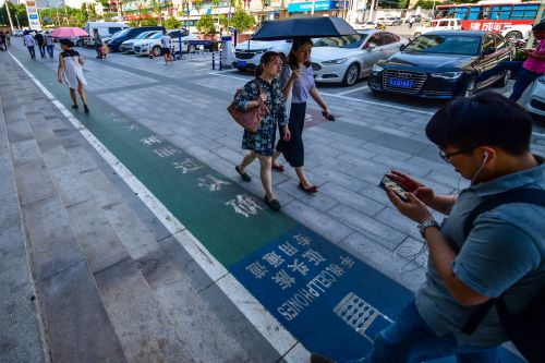 Chinese city opens pedestrian lane for obsessive texters