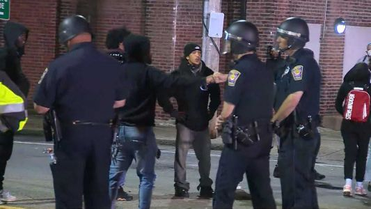 Brockton protesters fist bump with police after tense standoff