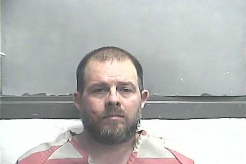 Meade County man arrested after wife, dog found dead