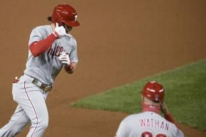 Harper's 2 HRs help Phils top Nats 12-3, eliminate champs