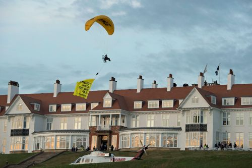 Police searching for protester who paraglided over resort where Trump is staying