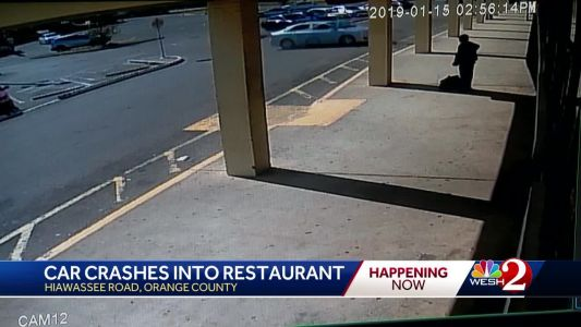 Video shows car crashing into Orange County restaurant