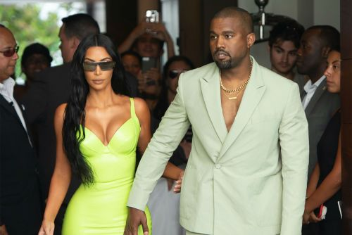 Kanye rolls into a wedding wearing socks and too-small sandals