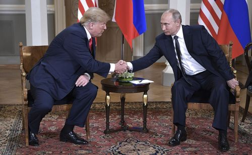 A Pizzagate truther is covering the Trump-Putin summit because that's the world we live in now