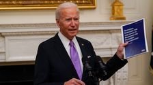 Biden Signs Executive Orders To Battle Pandemic: 'This Is A Wartime Undertaking'