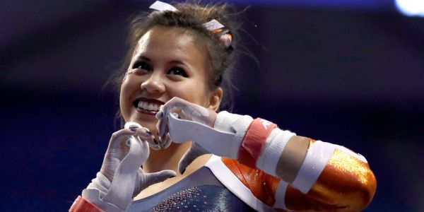 An college gymnast had a career-ending injury when she broke both of her legs during a floor routine