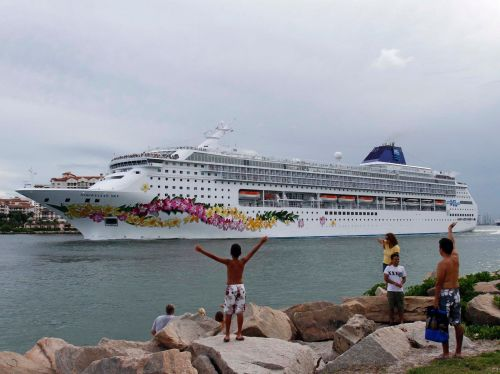 Norwegian Cruise Line will require crew members to get the COVID-19 vaccine before boarding as sailings continue to be pushed back