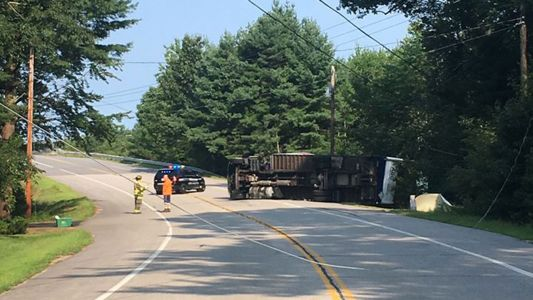 Portion of busy North Hampton road closed after truck rolls over