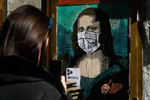 Mona Lisa depicted in face mask with smartphone as artist references coronavirus and more
