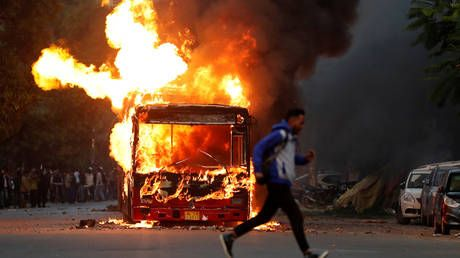 Protesters TORCH buses and clash with police in Delhi as Indian citizenship bill sparks street violence