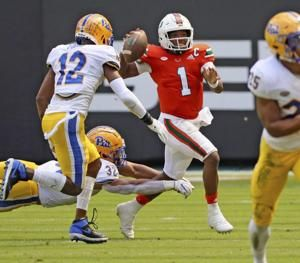 King fires four TDs as No. 13 Miami defeats Pitt