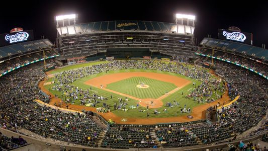 A's owner John Fisher decides to pay minor league players, says he 'made a mistake'