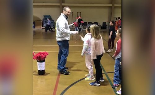 Sweet moment: Gym coach gives girls in his class roses to make them feel special on Valentine's Day